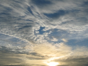 Sun in clouds copyright (c) Dec 2009, Kathy J Loh